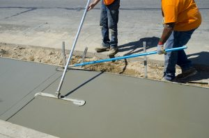 Workers laying concrete for a foundation in Reno